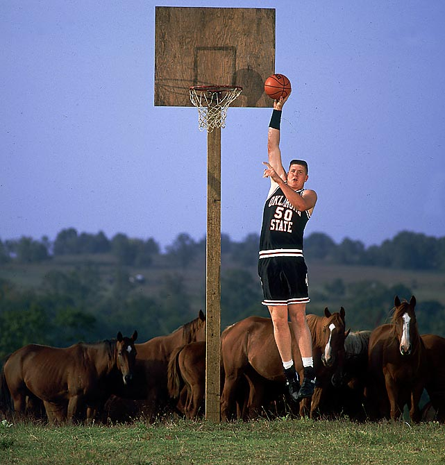 "Having grown up in a small rural farm community, no nickname could've seemed more appropriate for seven footer Bryant Reeves than ""Big Country."" This 1993 photo, taken while he was a student at Oklahoma State, perfectly captures him in his element."