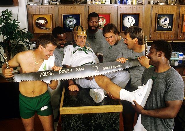 Philadelphia Eagles quarterback Ron Jaworski celebrates his Polish heritage while providing medical assistance to team trainer Otho Davis.