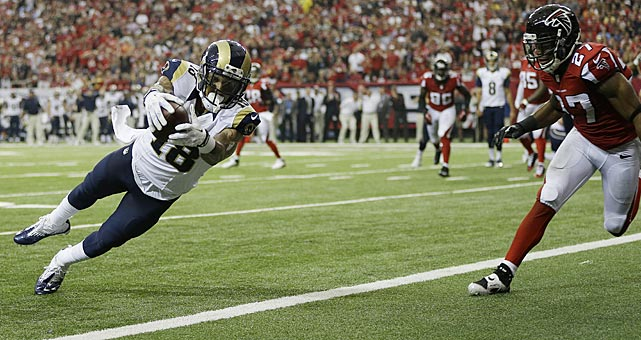 St. Louis wide receiver Austin Pettis scored ahead of Atlanta Falcons cornerback Robert McClain.