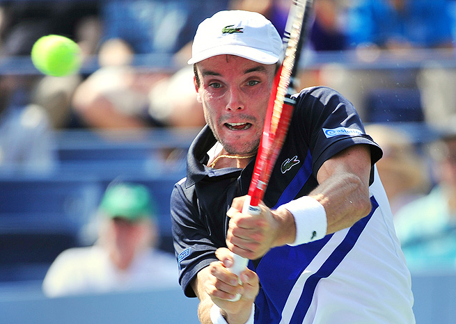 Roberto Bautista Agut upset No. 3-seed Janko Tipsarevic 7-6 (3), 6-3 in round one in St. Petersburg.
