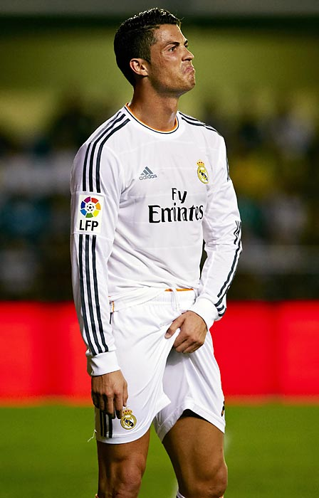 Using a gesture that parents and youth league coaches know well, Real Madrid midfielder Cristiano Ronaldo signals that he has to make a wee-wee during a match against Villareal CF.