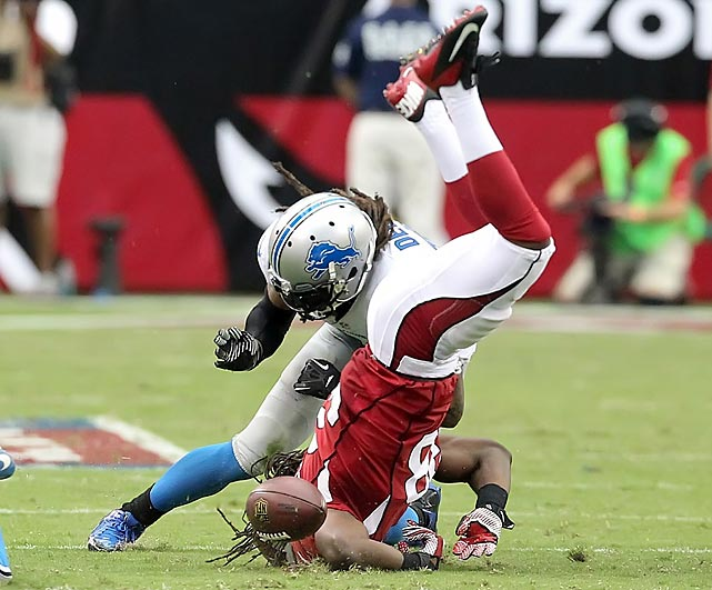 Arizona Cardinals running back Andre Ellington loses the football against the Detroit Lions. Upon further review, Ellington was ruled down by contact prior to the fumble.