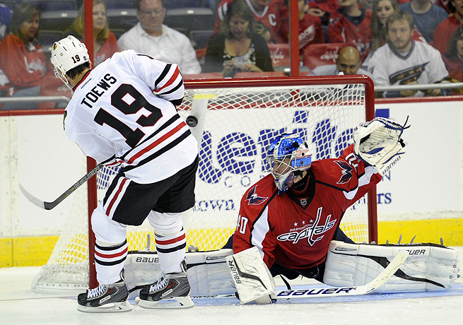 Jonathan Toews lifts the puck past Washington goalie David Leggio for the winning margin.