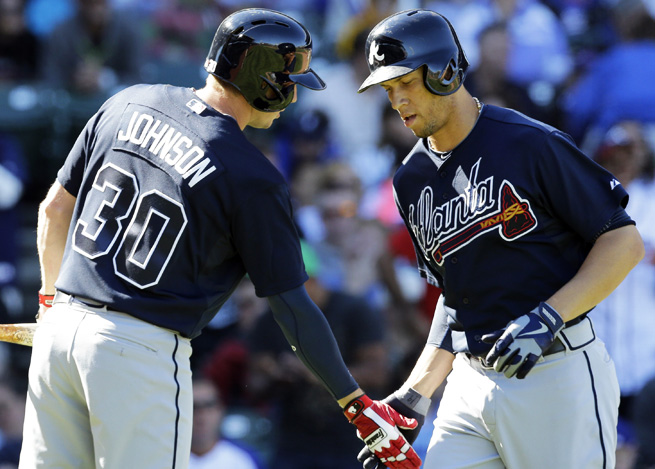 Chris Johnson and Andrelton Simmons celebrate during the Braves' game against the Cubs.