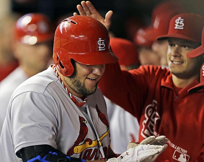 The Cardinals' Matt Adams celebrates after hitting a two-run home run on Saturday night.