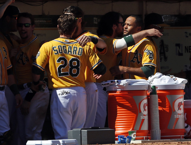 The A's congratulate one another after learning about learning they won the division.