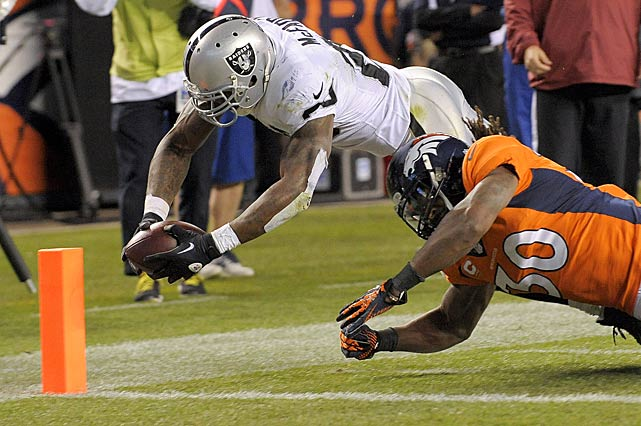 Oakland running back Darren McFadden was able to touch the pylon with this ball before landing out of bounds, giving the Raiders one of their two touchdowns against the Broncos.