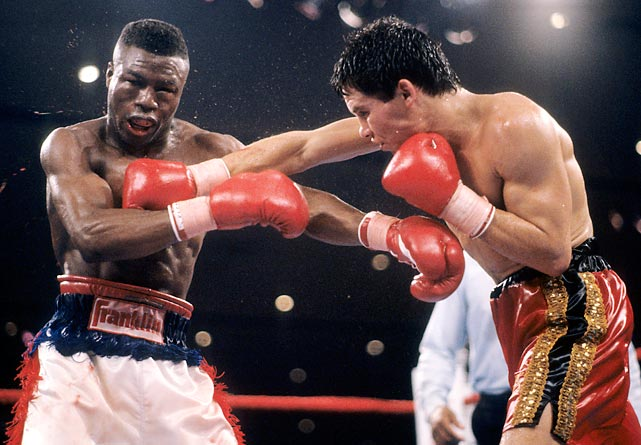 In one of the era's most highly-anticipated matches, Chávez brought his WBC lightweight title and 68-0 record into the ring at the Las Vegas Hilton to face 24-0-1 IBF champion and 1984 Olympic gold medalist Meldrick Taylor. In what would be acclaimed the Fight of the Year, both boxers took tremendous punishment but, going into the 12th and final round, Chávez was hopelessly behind on all three judges' cards. Fighting desperately, he dropped Taylor with 17 seconds to go. Taylor beat the count, but referee RIchard Steele, deeming him too badly hurt, shockingly stopped the bout at the 2:58 mark, giving Chávez the win by TKO and preserving his unbeaten streak.
