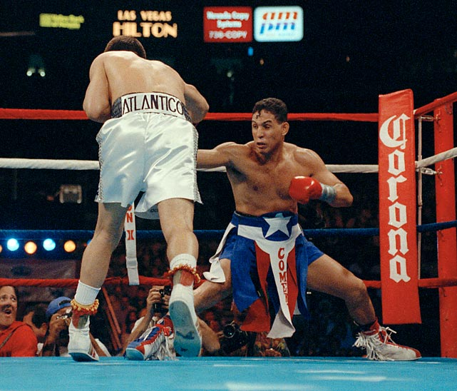 "It was a classic Mexico-Puerto Rico showdown and an equally classic match up of styles when Chávez defended his WBC super lightweight title against the WBO champ, Hector ""Macho"" Camacho in Las Vegas. Belying his nickname, the loincloth-sporting challenger was a defensive master who played a hit-and-run game. But despite some high-, or, rather, <italics>low</italics>lights, like this moment in the third round, he couldn't avoid the relentless charges and signature body punching of Chávez, who won a unanimous 12-round decision, further solidifying his status as boxing's reigning pound-for-pound king."