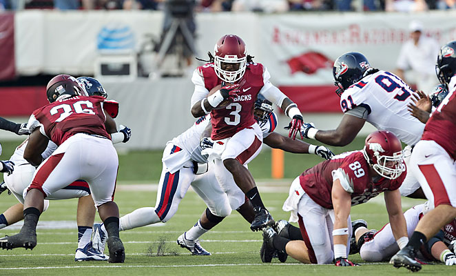 Alex Collins came to Arkansas to play in coach Bret Bielma's run-heavy offensive system.