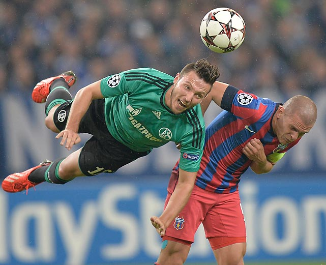 FC Schalke's Marco Hoeger, left, jumps for a header with Steaua Bucuresti's Alexandru Bourceanu, right, during a Champions League Group E match in Gelsenkirchen, Germany. Schalke won 3-0.