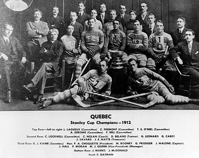 Malone's single-game goal record has stood for 93 years and may very well never be broken. On Jan. 31, 1920, the Hall of Fame forward (<italics>center, behind the Cup</italics>), the best goal-scorer of his era, potted seven for Quebec against the Toronto St. Patricks, helping the Bulldogs to a 10-6 home win. Malone nearly scored an eighth marker, but it was waved off. His feat didn't get much mention in the press, though. The NHL was only in its third season and the Bulldogs were 1-10 at the time, fellow also-ran Toronto 5-6. Plus, Malone had previous seven-, eight- and nine-goal games in other pro leagues.