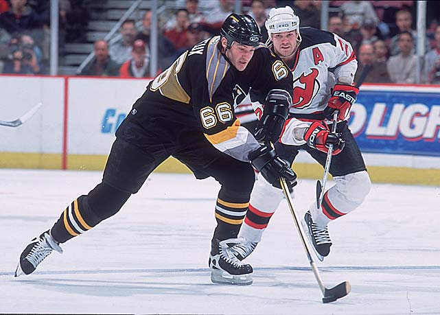One of the most dominating forwards of all time, Super Mario ended Gretzky's streak of seven consecutive scoring titles in 1988 and the two greats were rivals for the Art Ross Trophy well into the '90s. But Lemieux's most enduring feat is an odd one. On Dec. 31, 1988, he scored five goals five different ways: at even strength, shorthanded, on the power play, on a penalty shot and into an empty net as the Penguins topped the Devils, 8-6.