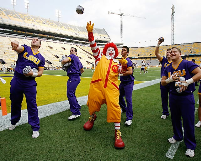 LSU's QB warmed up at Tiger Stadium with the spirit squad, slingin' burgers before the big game against the UAB Blazers.