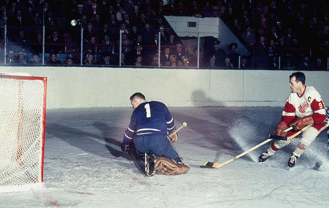 The Red Wings' Gordie Howe scores a goal on Maple Leafs goalie Johnny Bower in Toronto in the early 1960s.