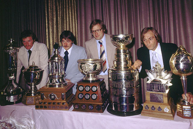(Left to right) Canadiens teammates Larry Robinson, Michel Larocque, Ken Dryden and Guy Lafleur pose with their trophies in Montreal following their 1977-78 championship season.