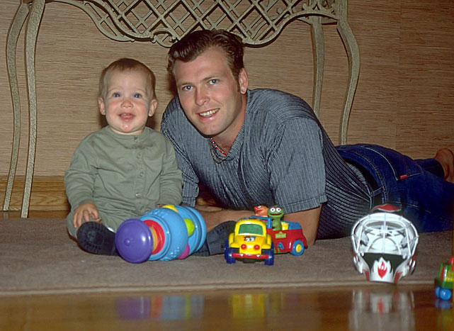 Martin Brodeur poses with his two-year-old son Anthony at their home in Montreal on Aug. 22, 1997. Anthony would grow up playing between the pipes like his father and was drafted by the New Jersey Devils in the 7th round of the 2013 NHL Draft.