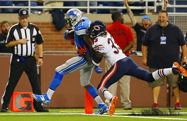 Detroit Lions running back Reggie Bush got to the front corner of the end zone before Charles Tillman could stop this 37-yard touchdown run.