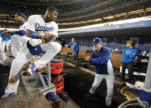 Dodgers hitting coach Mark McGwire gives the team's young phenom Yasiel Puig some pointers.