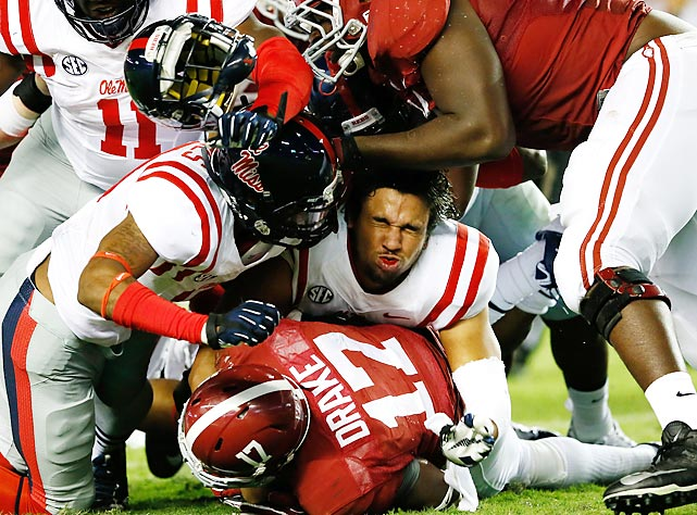 Mississippi's Cody Prewitt loses his helmet as he tackles Alabama running back Kenyan Drake.