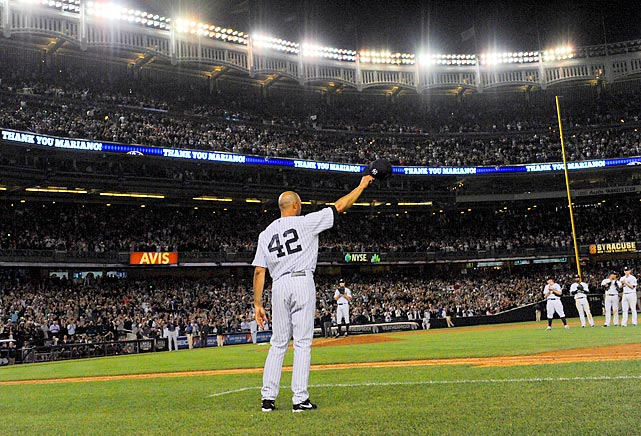New York Yankees closer Mariano Rivera waves to the crowd in his final game at Yankee Stadium. Rivera retires as baseball's all-time saves leader.