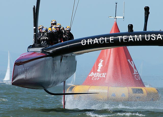 Oracle Team USA crosses the finish line during the America's Cup for its sterling come-from-behind victory.