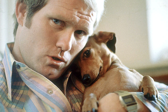 Pittsburgh Steelers quarterback Terry Bradshaw poses with his dachshund puppy, Rowdy, at his home in December 1978.