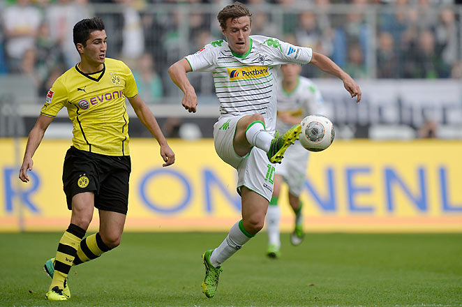 Max Kruse (right) scored Mönchengladbach's first goal as they defeated Dortmund 2-0 on Saturday.