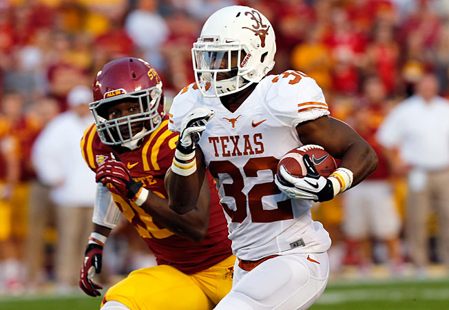 Johnathan Gray (32) rushed for 89 yards against Iowa State, but was the subject of a controversial call.