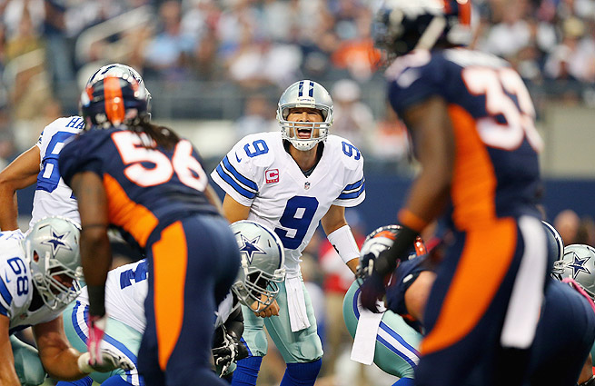 Tony Romo threw for a team-record 506 yards and five touchdowns, but his late interception cost the Cowboys the game.