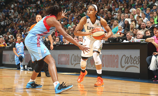 Maya Moore's 23 points helped the Minnesota Lynx lead for the entire game in the WNBA Finals opener.