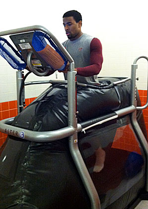 In the preliminary stages of his rehab, Antone Exum (shown here on an anti-gravity treadmill) worked on improving his extremely restricted range of motion and limited strength.