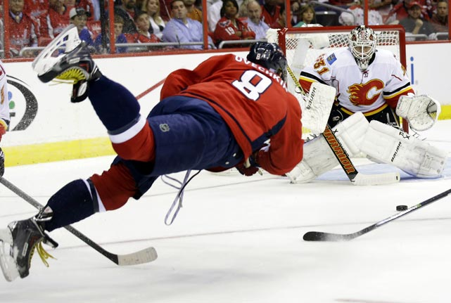 Washington Capitals right wing Alex Ovechkin takes a diving shot that is blocked by Calgary Flames goalie Karri Ramo in the first period of an NHL game on Oct. 3.