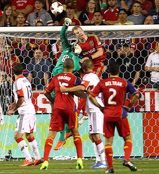 Bill Hamid (28) of D.C United punches the ball away from Chris Wingert of Real Salt Lake during the final of the U.S. Open Cup at Rio Tinto stadium, in Sandy, Utah. D.C United won 1-0.