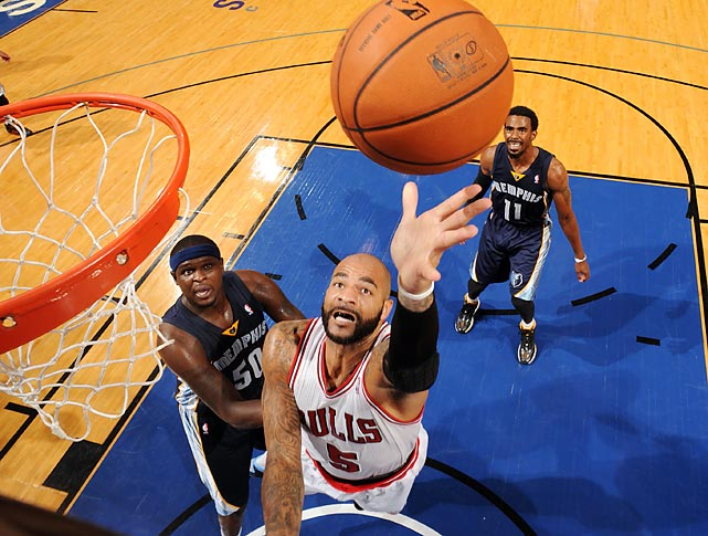 Chicago Bulls forward Carlos Boozer goes up for a shot against the Memphis Grizzlies on Oct. 7.