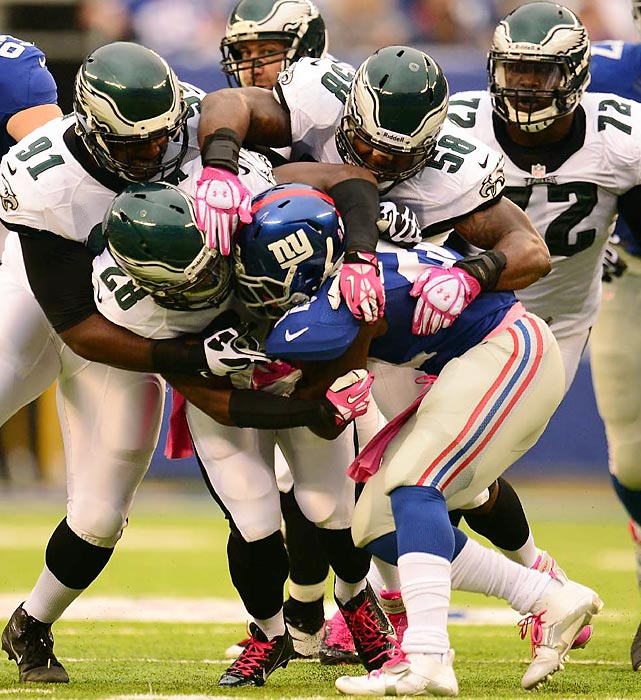 The Philadelphia Eagles defense gangs up on New York Giants running back David Wilson.