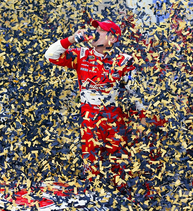Driver Kevin Harvick celebrates in victory lane after winning the NASCAR Sprint Cup series race in Kansas City, Oct. 6.