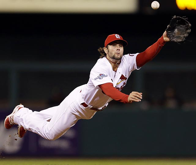 St. Louis Cardinals shortstop Pete Kozma makes a diving catch of a ball hit by Pittsburgh Pirates' Neil Walker in the fourth inning of Game 5 of a National League baseball division series.