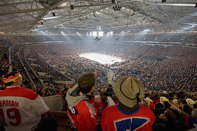 The opening game of the 74th IIHF World Ice Hockey Championship set a world record for largest crowd at a ice hockey game at the time with 77,803 spectators at Veltins-Arena, normally a soccer venue, on May 7, 2010. Germany won 2-1 in overtime.