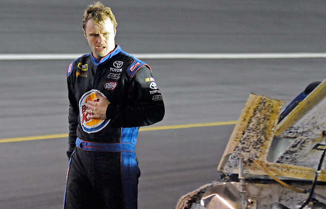 Travis Kvapil will race in Charlotte after being arrested on charges of domestic assault.