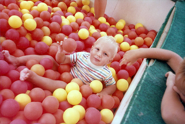 A three-year-old Gronk shows his athletic prowess in a ball pit.