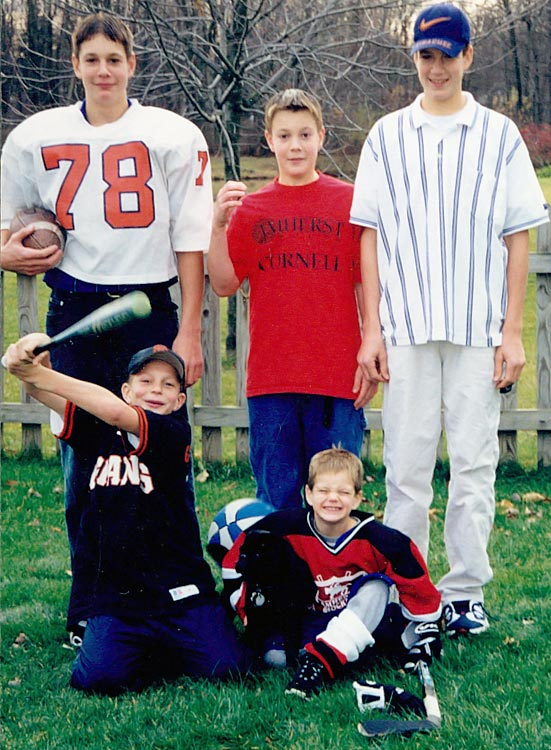 An eight-year-old Rob Gronkowski (bottom left) poses with his brothers (clockwise from left) Dan, Chris, Gordie and Glenn. In 2010, Chris, Dan and Rob became the first three brothers to play in the NFL at the same time since 1992.
