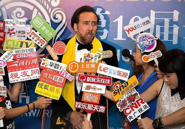 That Caged feeling: the beloved thespian attempted to speak to the swarming media jackals after winning the Best Global Actor in Motion Pictures tsotchke at the Huading Awards ceremony in Macau, Macau. Which is apparently in Macau.