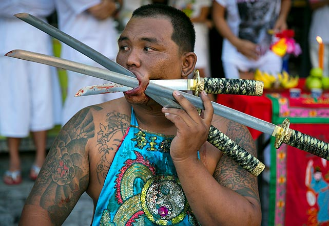 This guy is obviously a big Sabres fan. Bet you didn't know that devotees of veggies get themselves skewered like shish kebabs at the Bang Neow shrine in Phuket, Thailand. Ritual Vegetarianism and Sabres fandom in Phuket Island happens to trace it roots, so to speak, back to the early 1800's. The festival begins on the first evening of the ninth lunar month and lasts for nine painful days. Participants in the festival perform acts of piercing as a means of shifting evil spirits from individuals onto themselves and bringing their community good luck. Hey, you never know.