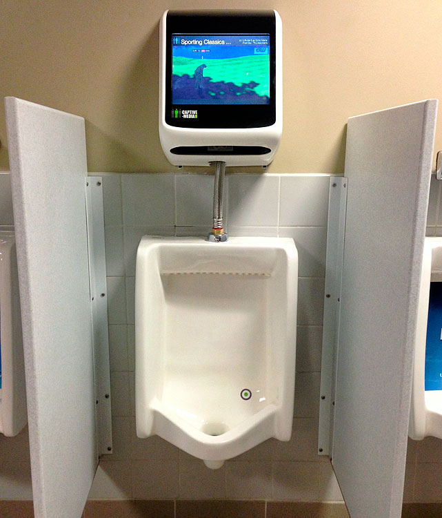 """Coca-Cola Park in Allentown, Pa., home of the Triple A Lehigh Valley IronPigs, is unveiling a Urinal Gaming System in its restrooms that will allow men to """"engage with the screen by aiming in different directions to test their ability and knowledge."""""""