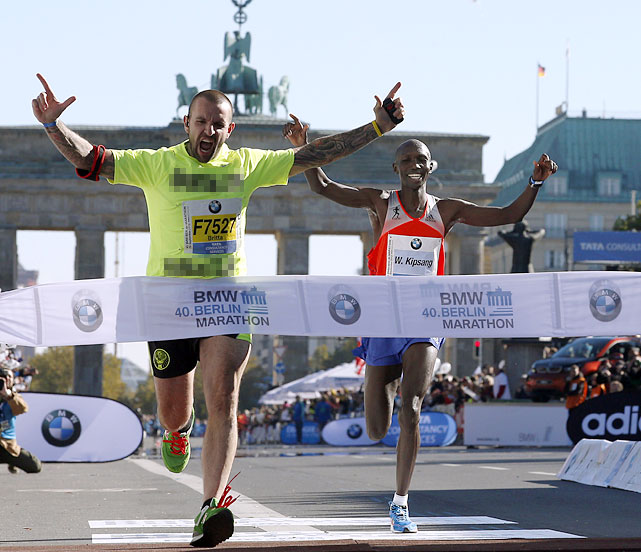 Wilson Kipsang didn't get to break the tape in his world-record marathon run in Berlin on Sept. 29 (2:03:23) because a man in a T-shirt promoting a prostitution website ran onto the course and beat him to it.