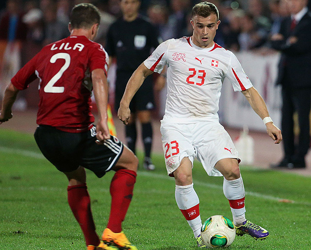 Xherdan Shaqiri (right), who plies his trade for Bayern Munich in the Bundesliga, opened the scoring for the Swiss in the 47th minute of their 2-1, World Cup berth-clinching win over Albania. 2014 will mark Switzerland's third straight World Cup appearance.