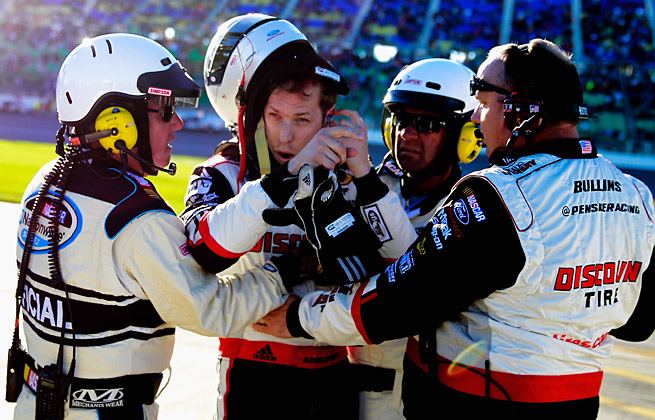 Brad Keselowski had to be held back by his crew after a wreck caused by Kyle Busch in Kansas City.