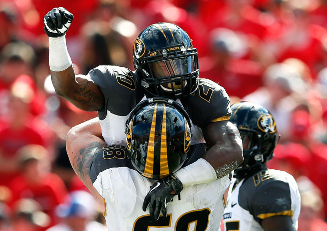 Henry Josey (20) ran for a seven-yard touchdown in the fourth quarter to ice Missouri's win at Georgia.
