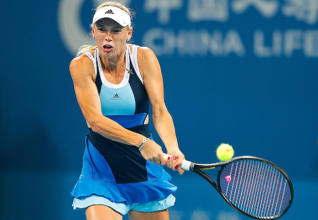 Caroline Wozniacki squeaked by Mandy Minella 6-3, 7-6 (2) in the first round of the Luxembourg Open.